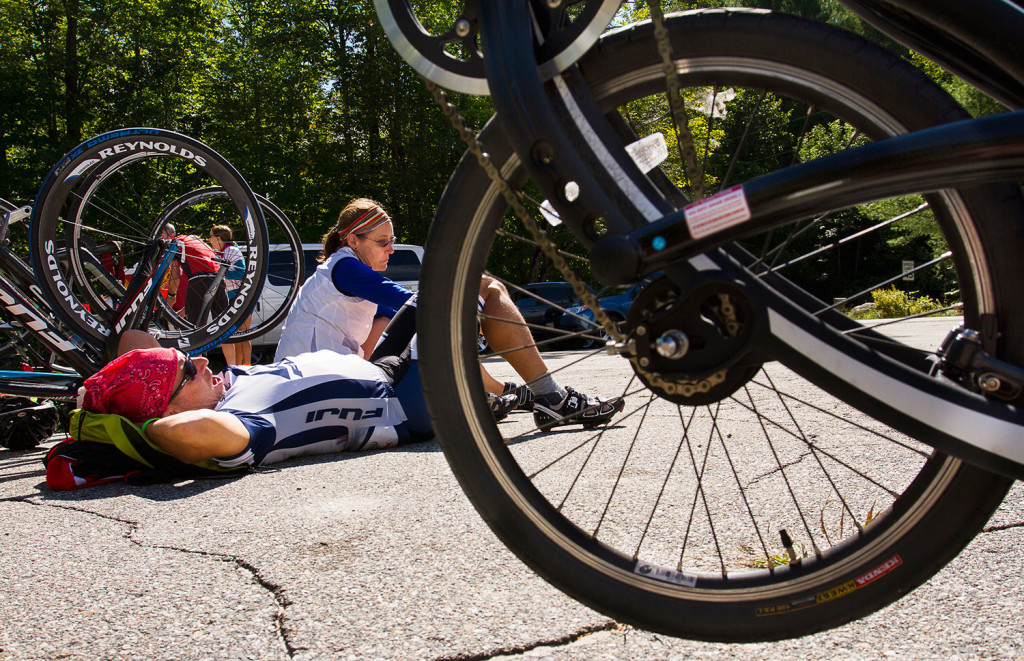 SEBAGO, ME - SEPTEMBER 14: Steve Key of Orlando, Fla takes a rest during lunch break, with Tracy Cook, also of Orlando, at the Sebago Center Community Church of the Bike Maine trek on Monday, September 14, 2015. The 350-mile long trip, sponsored by the Bicycle Coalition of Maine, will bring the 360 riders from Kittery, back to kittery via Old Orchard Beach, Bridgton, Bethel Sweden and Kennebunk. (Photo by Carl D. Walsh/Staff Photographer)